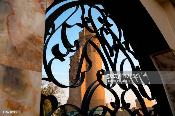 This picture shows the former minaret of Shiite Imam Ali's historical mosque in the southern Iraqi city of Basra on July 21 2019 The mosque which was...