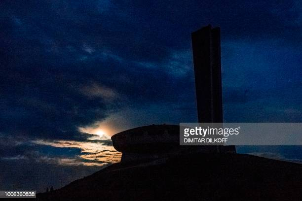This picture shows the full moon before a 'blood moon' eclipse behind the Memorial House of the Bulgarian Communist Party on mount Buzludzha some 120...