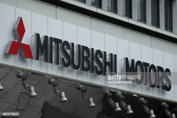 This picture shows the logo of Japan's Mitsubishi Motors Corporation displayed at the company's head office in Tokyo on May 9 2017 Mitsubishi Motors...