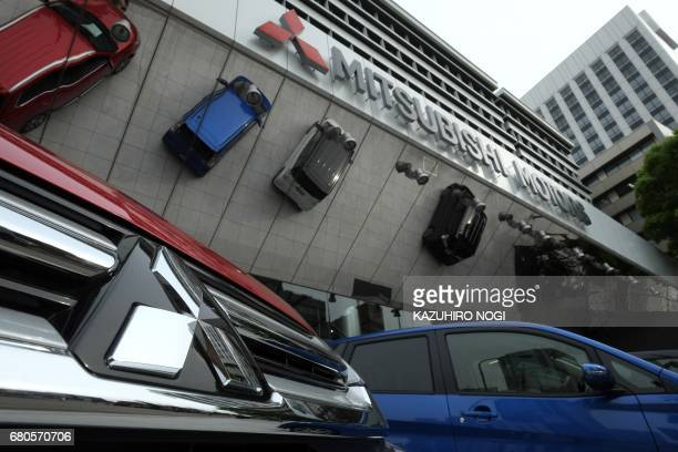 This picture shows the logo of Japan's Mitsubishi Motors Corporation displayed at the company's head office in Tokyo on May 9, 2017. Mitsubishi...