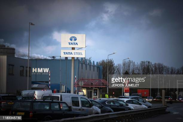 This picture shows the main gate at Tata Steel in IJmuiden, on November 19, 2019. - The steel group is stepping up its reorganization plans in Europe...