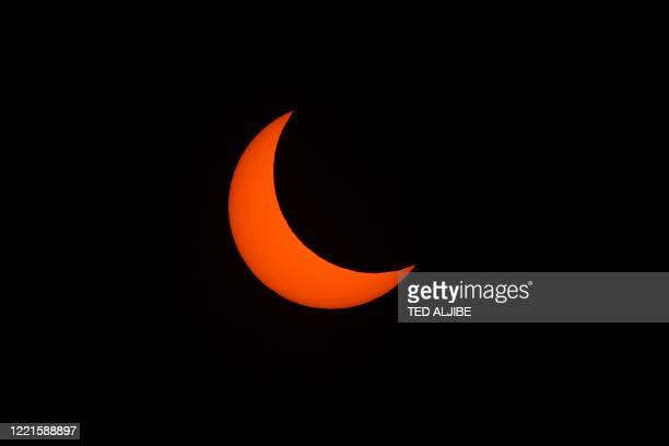 This picture shows the moon passing in front of the sun during a annular solar eclipse in Manila on June 21 2020