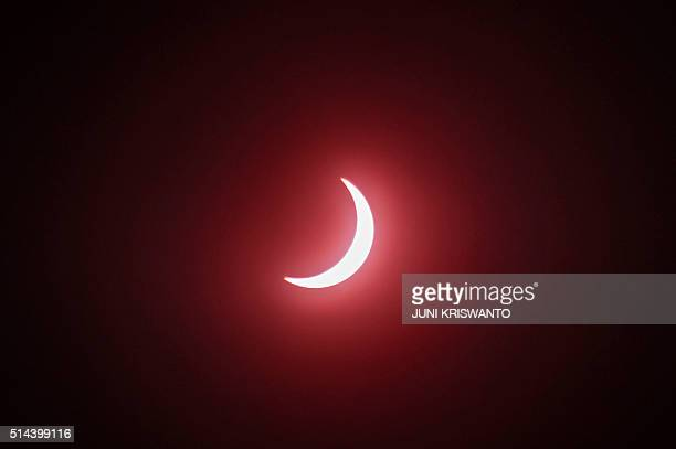 TOPSHOT This picture shows the moon passing in front of the sun during a total solar eclipse in Surabaya East Java on March 9 2016 A total solar...