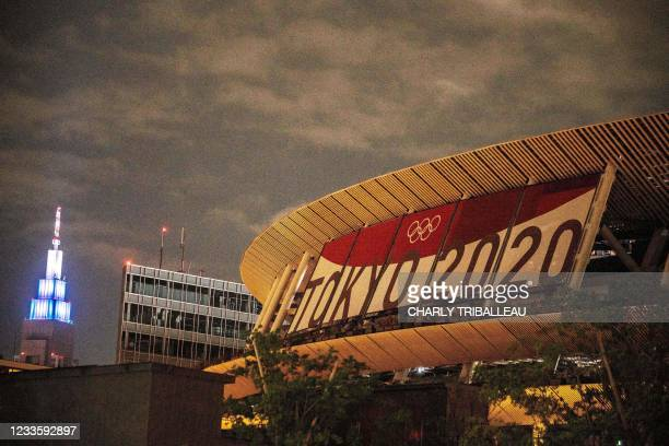 This picture shows the National Stadium, main venue for the Tokyo 2020 Olympic and Paralympic Games, 30 days before the opening ceremony, in Tokyo on...