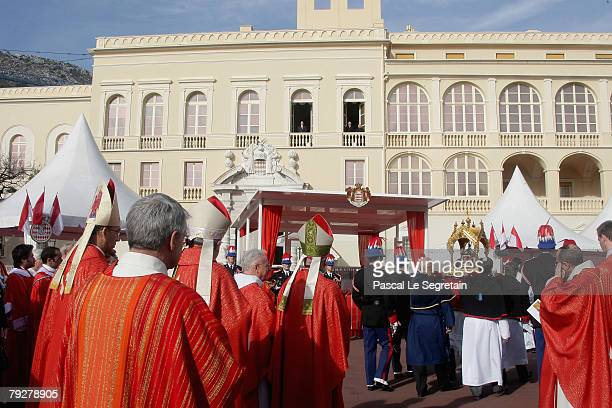 This picture shows the religious parade passing by the Royal Palace Square as part of the annual Sainte Devote celebration Monaco's patron saint on...
