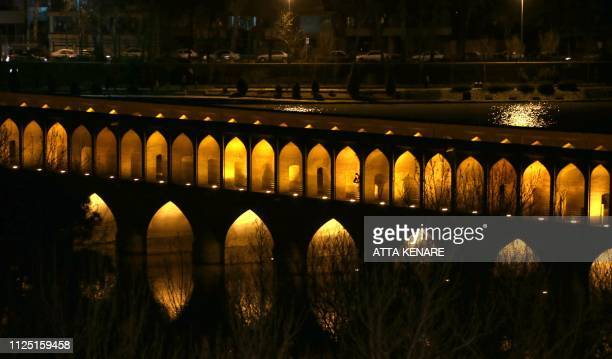 """This picture shows the """"Si-o-Se Pol"""" bridge over the Zayandeh Rud river in Isfahan, on February 16, 2019. - For a few days The water of the dam is..."""