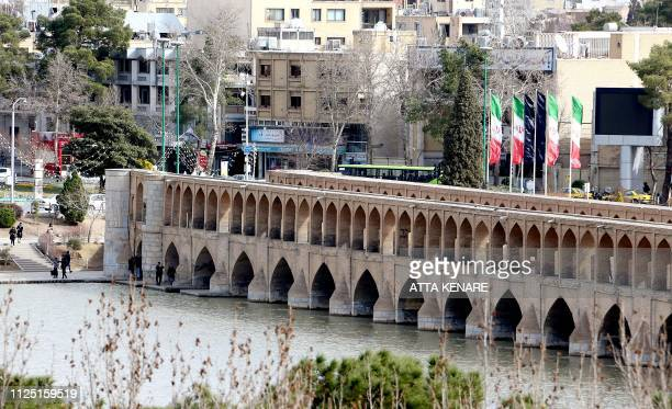 "This picture shows the ""Si-o-Se Pol"" bridge over the Zayandeh Rud river in Isfahan, on February 16, 2019. - For a few days the water of the dam is..."