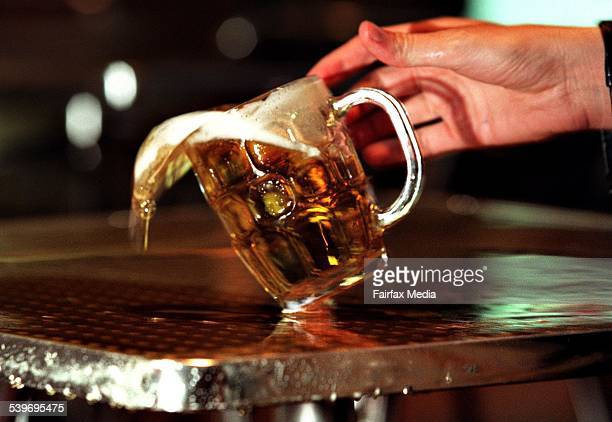 This picture shows the spillage of a beer mug onto a table 29 May 2000 AFR Picture by PHIL CARRICK