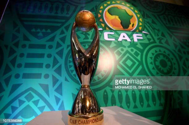 TOPSHOT This picture shows the trophy prior to the draw of the Confederation of African Football's Champions league at the Ritz Carlton Hotel in...