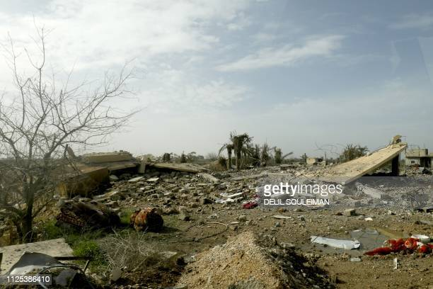 This picture shows trees and destructions during an operation to expel Islamic State group jihadists from their last bastion in Baghouz in the...
