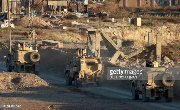 This picture shows US army vehicles supporting the Syrian Democratic Forces in Hajin in the Deir Ezzor province eastern Syria on December 15 2018...
