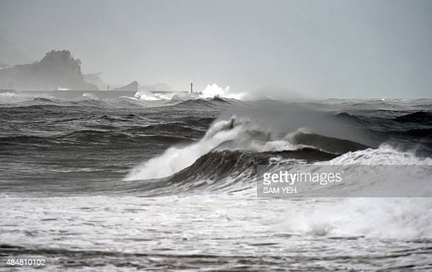 This picture shows waves near the Wushih harbor in Yilan as typhoon Goni approaches in eastern Taiwan on August 22 2015 Two people were killed while...