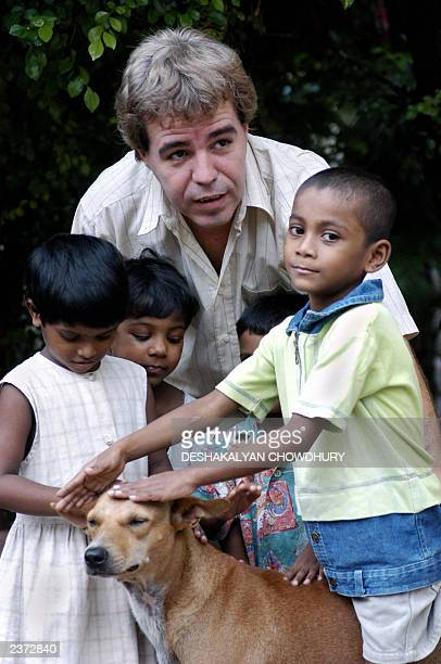 "This picture taken 01 August 2003 shows Thierry Darnaudet, a French social worker and head of the NGO ""New Light"", standing with Indian children and..."