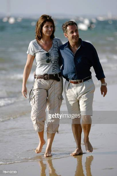 ANNEE This picture taken 05 August 2006 shows then French Interior minister Nicolas Sarkozy and his wife Cecilia on the Pyla beach southwestern...