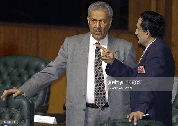 This picture taken 06 January 2004 shows father of Pakistan's nuclear bomb Abdul Qadeer Khan talking to an unidentified official during the closing...