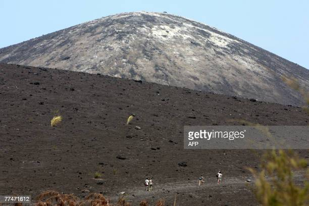 This picture taken 19 October 2007 shows tourists hiking along the track of Anak Krakatau literally Child of Krakatau volcano in the Sunda Straits...