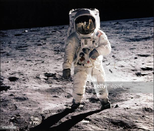This picture taken 20th July 1969 of astronaut Edwin E Aldrin Jr walking on the surface of the moon near the leg of the Lunar Module Eagle and...