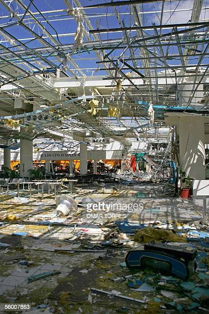 This picture taken 25 October 2005 shows the destruction caused at Cancun's airport Terminal 1 by the devastating passage of Hurricane Wilma in the...