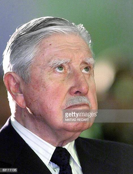 This picture taken 30 August 2000 shows General Augusto Pinochet taking part in a mass at the Navy chapel in Vina del Mar 100 Km west of Santiago...
