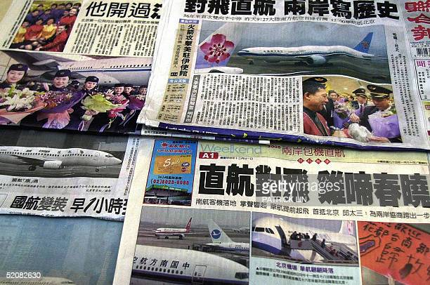 This picture taken 30 January 2005 shows front pages of Taiwan's newspapers reporting the 29 January first direct flights between Taiwan and the...