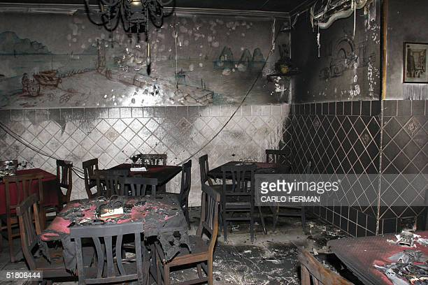 This picture taken 30 November 2004 shows a burned pizzeria in Naples in a series of mafialinked murders Demonstrators coupled a protest against...