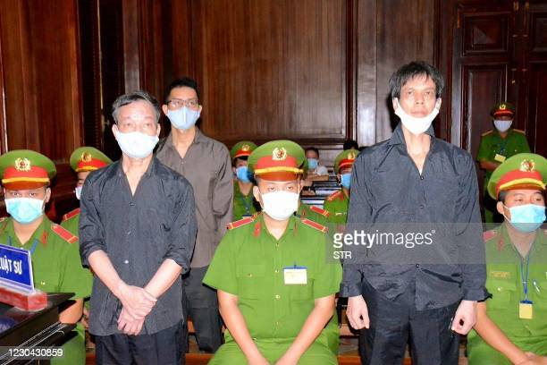 This picture taken and released by the Vietnam News Agency on January 5, 2021 shows Vietnamese bloggers Pham Chi Dung , Nguyen Tuong Thuy and Le Huu...