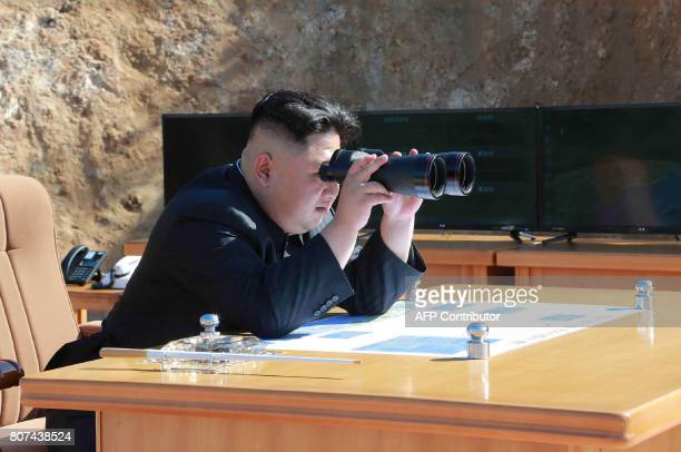 This picture taken and released on July 4 2017 by North Korea's official Korean Central News Agency shows North Korean leader Kim JongUn inspecting...