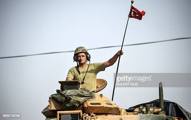 This picture taken around 5 kilometres west from the Turkish Syrian border city of Karkamis in the southern region of Gaziantep, on August 25, 2016...