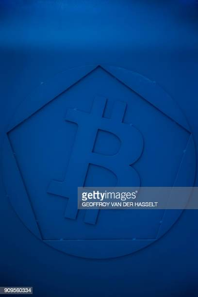 This picture taken at La Maison du Bitcoin in Paris on January 17 2018 shows a bitcoin logo / AFP PHOTO / GEOFFROY VAN DER HASSELT
