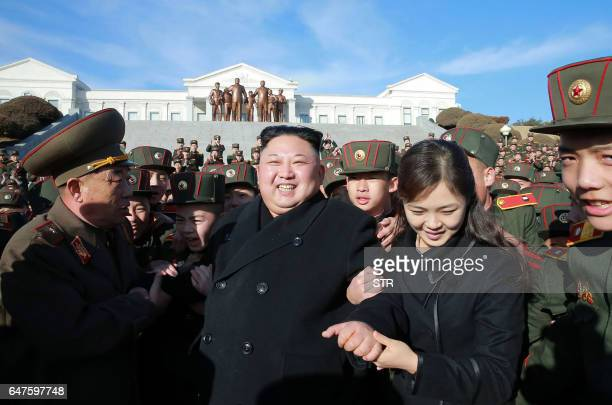 This picture taken by North Korean news agency KCNA on March 2 2017 and released on March 3 shows North Korean leader Kim JongUn and his wife Ri...