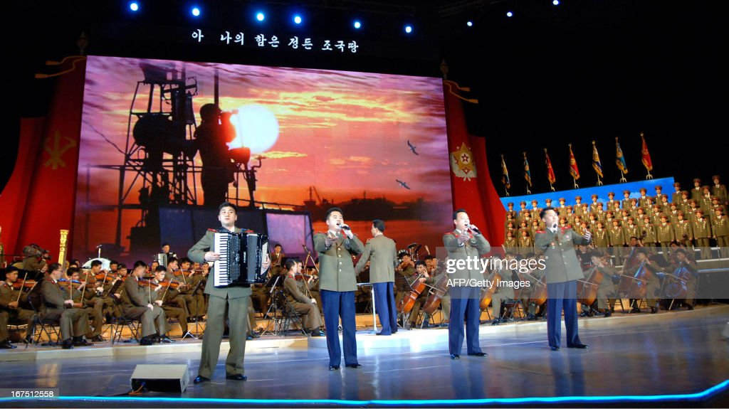 This picture taken by North Korea's official Korean Central News Agency (KCNA) on April 25, 2013 shows a performance of 'Song of Final Victors', given by North Korea's State Merited Chorus in Pyongyang for the 81st anniversary of the founding of the Korean People's Army (KPA). AFP PHOTO / KCNA via KNSTHIS PICTURE WAS MADE AVAILABLE BY A THIRD PARTY. AFP CAN NOT INDEPENDENTLY VERIFY THE AUTHENTICITY, LOCATION, DATE OR CONTENT OF THIS IMAGE. THIS PHOTO IS DISTRIBUTED EXACTLY AS RECEIVED BY AFP.---EDITORS NOTE--- RESTRICTED TO EDITORIAL USE - MANDATORY CREDIT 'AFP PHOTO / KCNA VIA KNS' - NO