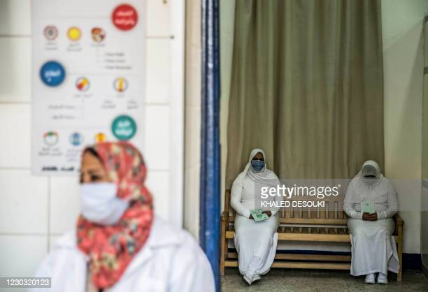 This picture taken during a government-guided tour on December 27, 2020 shows inmates, mask-clad due to the COVID-19 coronavirus pandemic, waiting at...