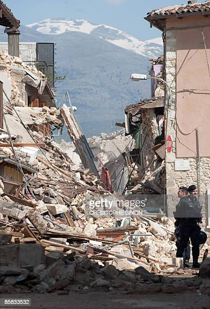 This picture taken during a guided tour with Italian firemen shows carabineris standing guard near destroyed houses after a violent earthquake the...