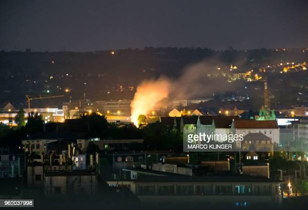 TOPSHOT This picture taken during the night of May 23 shows a burning spot on the site in Dresden eastern Germany where a World War II bomb was found...