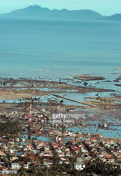 This picture taken from a US Seahawk helicopter en route to a relief mission shows one of the tsunami devastated area in Banda Aceh 13 January 2005...