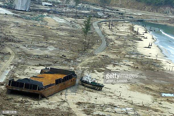 This picture taken from a US Seahawk helicopter en route to a relief mission in the remote areas shows a tsunami devastated area in Suak Beka west...