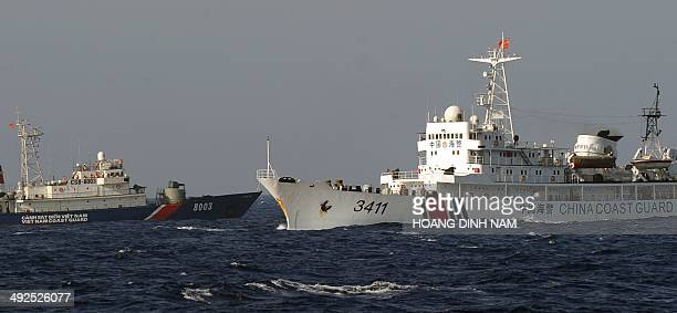 This picture taken from a Vietnam Coast Guard ship on May 14 2014 shows a Vietnamese Coast Guard ship is challended by a China Coast Guard ship near...
