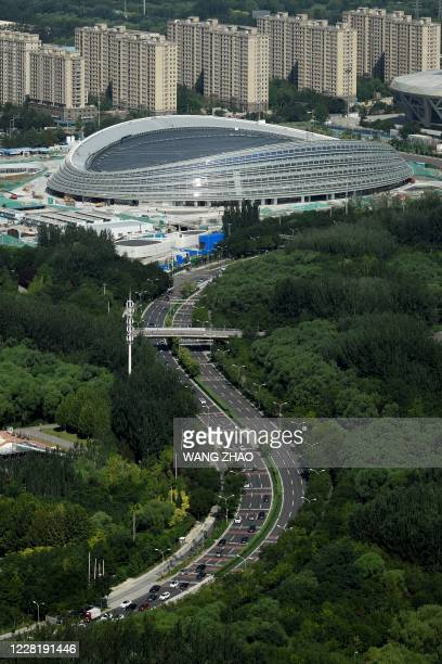 This picture taken from the Beijing Olympic Tower shows a general view of the National Speed Skating Oval also known as the Ice Ribbon the venue for...