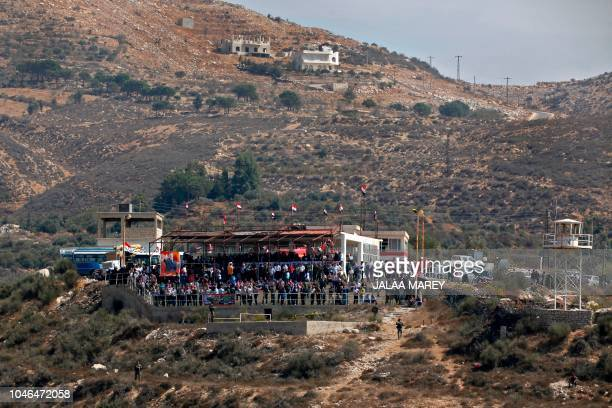 This picture taken from the Druze village of Majdal Shams in the Israel-annexed Golan heights on October 6, 2018 shows members of the Druze community...