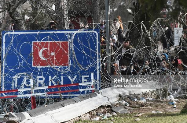 This picture taken from the Greek side of the GreeceTurkey border near Kastanies shows migrants waiting on the Turkish side on March 2 2020 Greece...