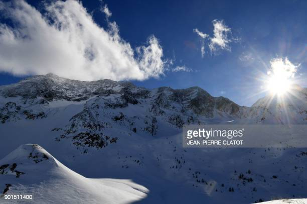 This picture taken from the high mountain pass 'Col du Lautaret ' shows the Massif des Ecrins mountains in the French Alps on January 5 2018 / AFP...