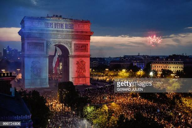 TOPSHOT This picture taken from the terrace of the Publicis drugstore on July 15 2018 shows a projection reading 'Proud of being Blue' with French...
