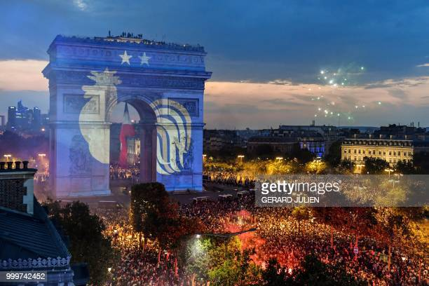 TOPSHOT This picture taken from the terrace of the Publicis drugstore on July 15 2018 shows a projection of the French national football team logo...