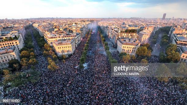 TOPSHOT This picture taken from the top of the Arch of Triumph on July 15 2018 shows people celebrating after France won the Russia 2018 World Cup...