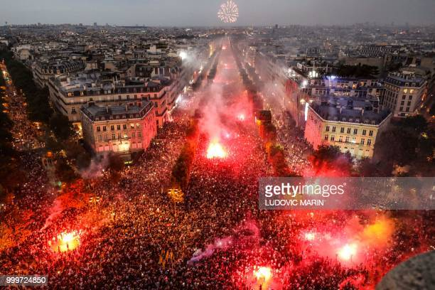 TOPSHOT This picture taken from the top of the Arch of Triumph on July 15 2018 shows people lighting flares as they celebrate after France won the...