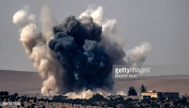 This picture taken from the Turkish Syrian border city of Karkamis in the southern region of Gaziantep on August 24 2016 shows smoke billows...