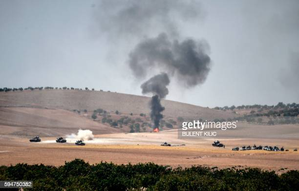 TOPSHOT This picture taken from the Turkish Syrian border city of Karkamis in the southern region of Gaziantep on August 24 2016 shows Turkish army...