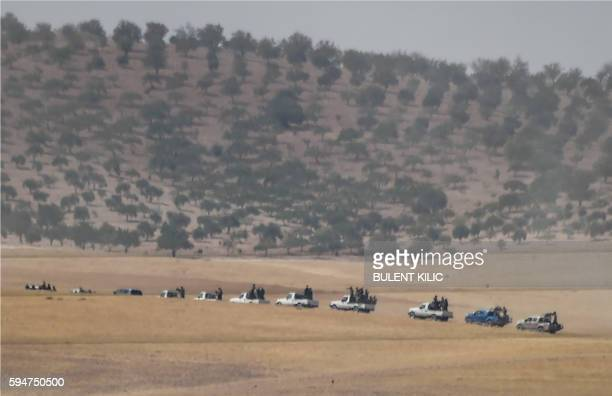TOPSHOT This picture taken from the Turkish Syrian border city of Karkamis in the southern region of Gaziantep on August 24 2016 shows proAnkara...