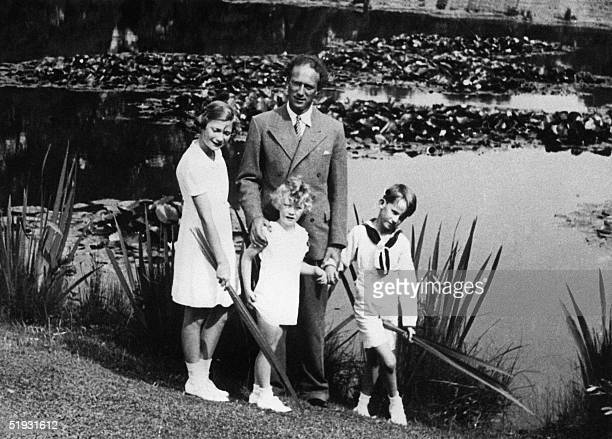 This picture taken in 1935 in Brussels shows King of Belgium Leopold III posing with his children Princes JosephineCharlotte and Prince Albert and...