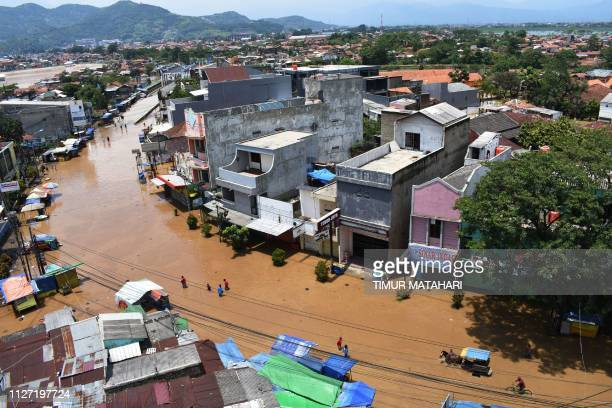 This picture taken in Bandung West Java on February 24 shows a general view of the floods Hundreds of houses submerged as flood frequently occurred...